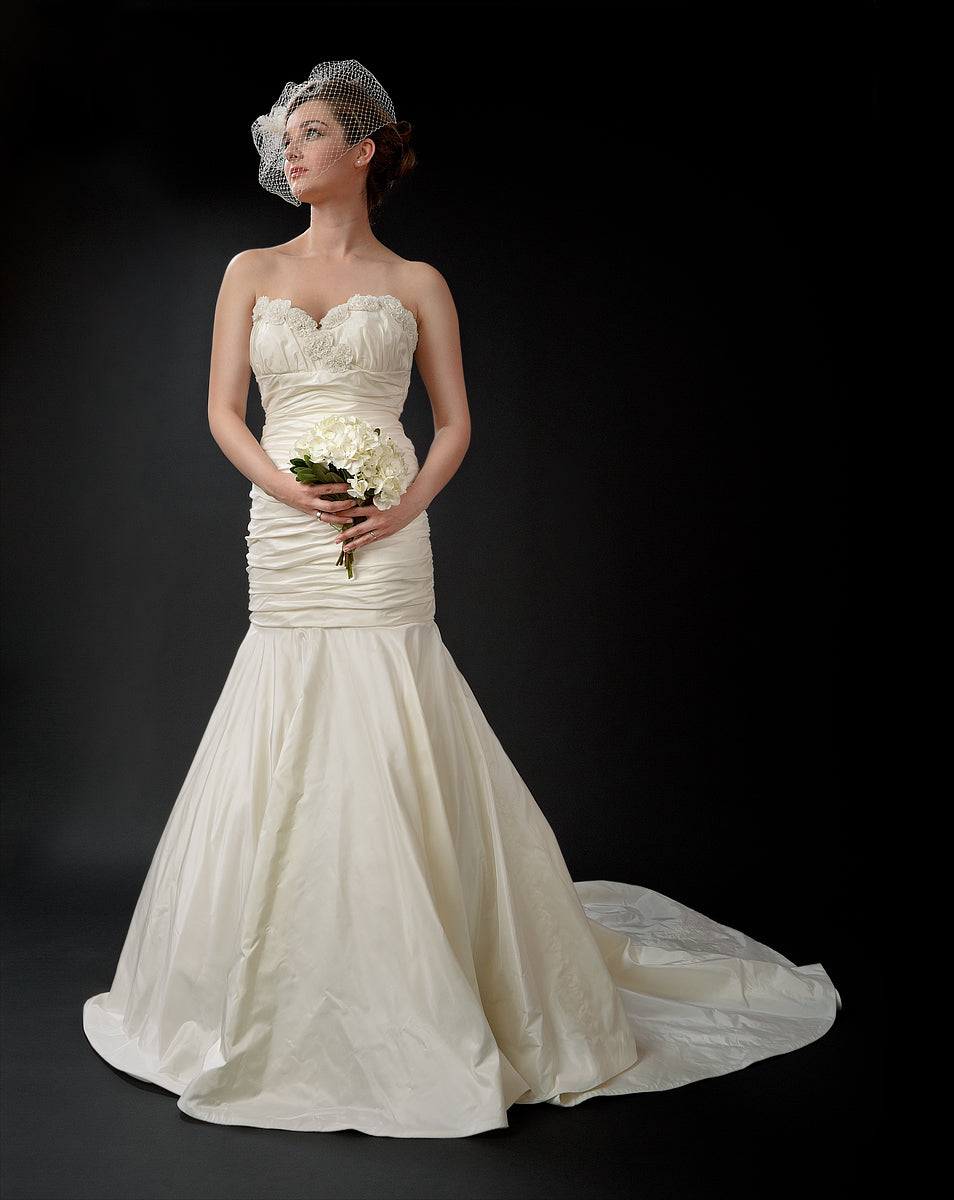 anna nieman designer wedding dress Boston. A Classic mermaid gown from silk/taffeta with ruched bodice and an appliquéd neck-line