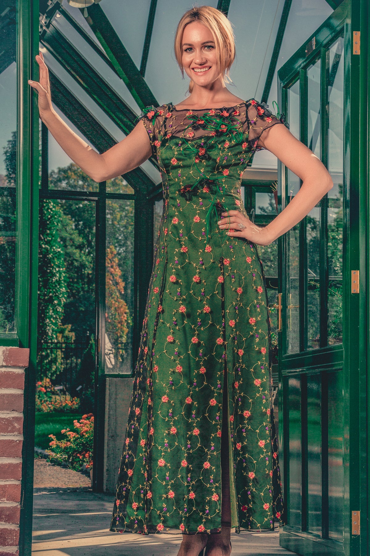 anna nieman designer dress Boston. A long gown from embroidered silk organza, has a flattering svelte silhouette. Hand-made flowers give a delicate and luxurious look.
