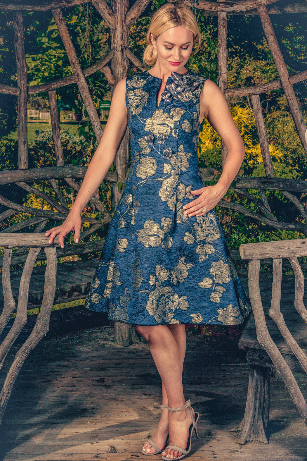 anna nieman designer dress Boston. A dress made from Swiss metallic brocade, with a fit-and-flare silhouette, has the comfort of weightless fabric with three-dimensional silvery / navy pattern.