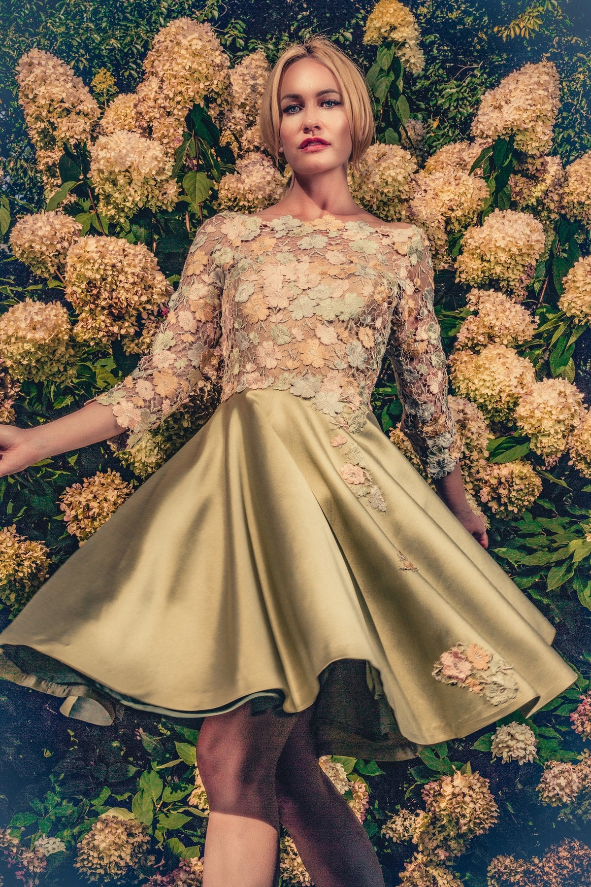 anna nieman designer dress Boston. A swirl dress made from silvery-goldish french Guipure lace. You will blend in perfect unison with the flowers during your garden party.