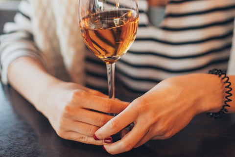 Holding a wine glass