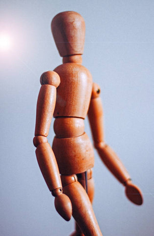 Wooden human body figurine