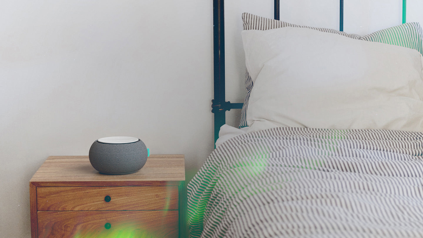 SNOOZ White Noise Machine on Bedside Nightstand