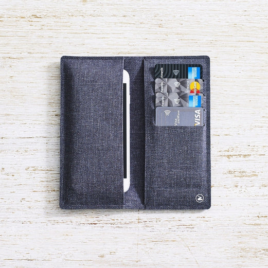 Zilfer Phone Wallet In Grey Open With iPhone and Credit Cards On Light Wood Desk