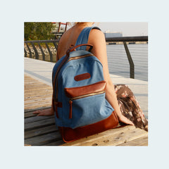 Denim Backpack - Sky Blue with Cognac Brown Leather - Woman sitting