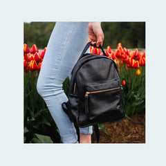Limited Leather - Mini Backpack - Black - Carried with flowers