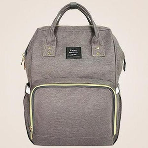 This Pink Grey LAND Tote Diaper Backpack is sturdy with adequate storage compartments for bottles, diapers, snacks, toys and phones. It can be used as a practical backpack or a stylish tote bag, both styles are sophisticated!