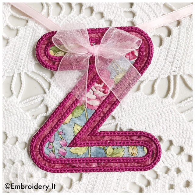 machine embroidered banner letter