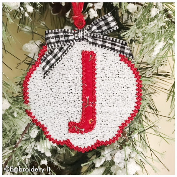 Machine embroidery letter J freestanding lace pattern