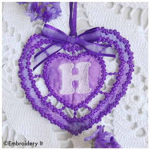 Machine embroidery cutwork monogram heart design