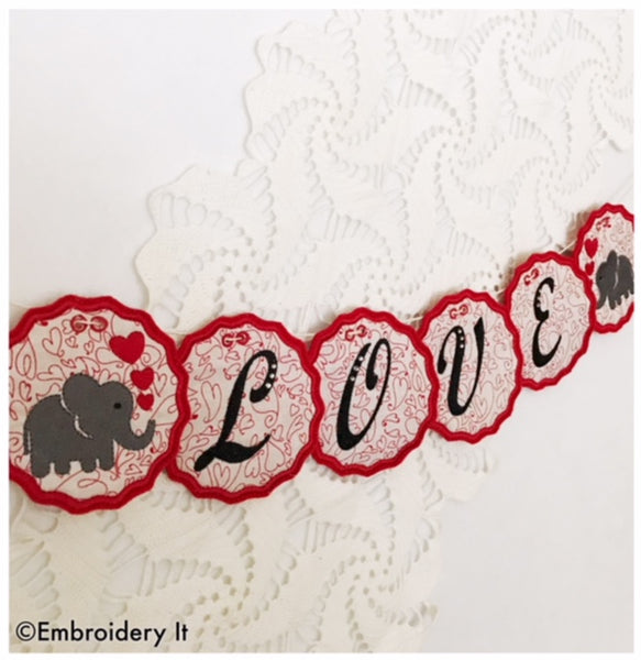 Machine embroidery in the hoop love banner