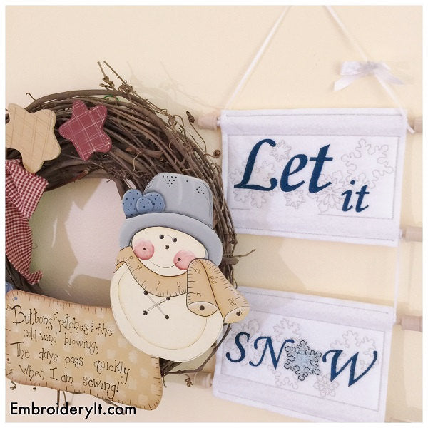 Machine embroidery let it snow sign