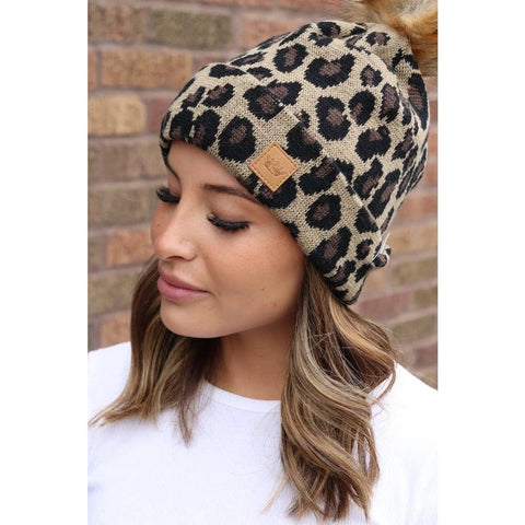 Animal Print Winter Hat with Brown Pom Pom