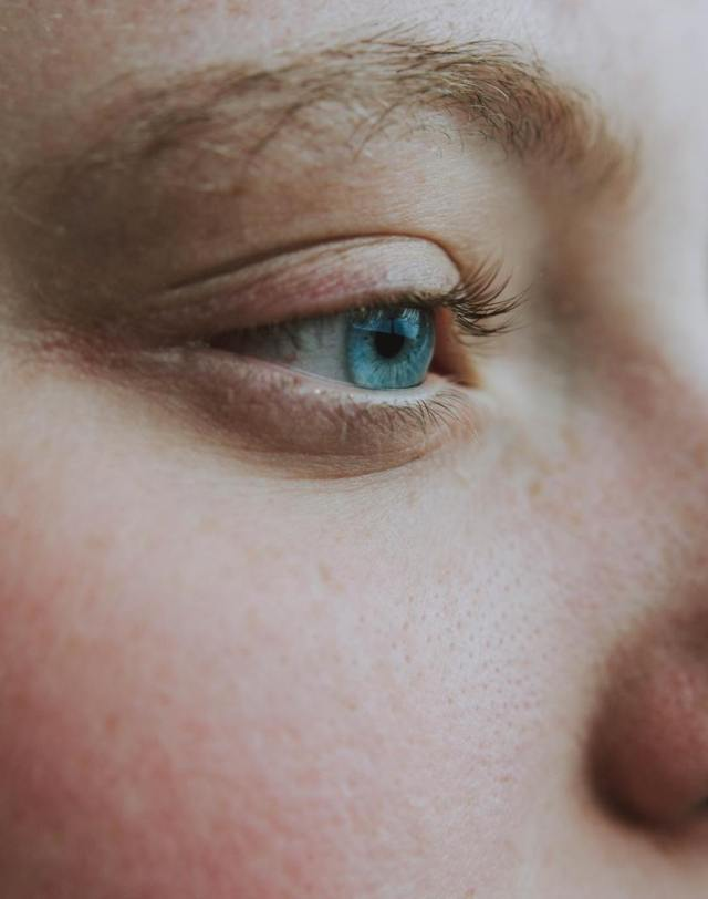 face of a woman with blue eyes close up