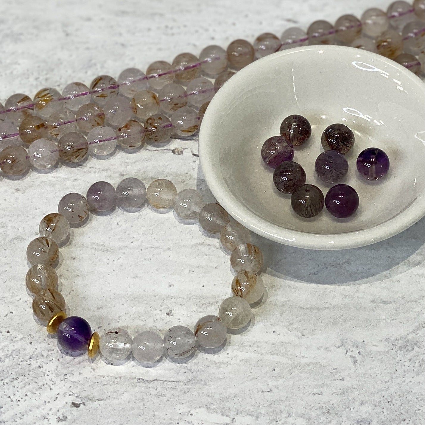 Rutilated Amethyst Strand - 8.5mm Round