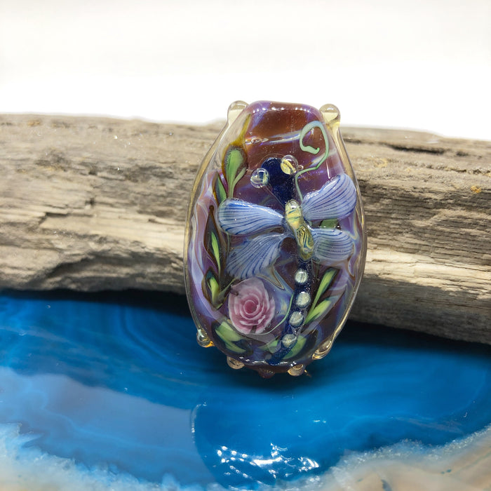 Striped Blue Dragonfly on Burgundy Lampwork Bead by Calvin Orr