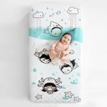 Fitted baby crib sheet by Rookie Humans, Dive In. Illustrated by Elisa Sassi. Designed for the modern nursery, packaged to make a unique baby shower gift. Underwater theme, under the sea nursery theme, under the ocean nursery theme, nautical nursery theme.