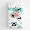 Fitted baby crib sheet by Rookie Humans, Dive In. Illustrated by Elisa Sassi. Designed for the modern nursery, packaged to make a unique baby shower gift.