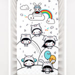 Fitted baby crib sheet by Rookie Humans, Party In My Crib, rainbow baby crib sheet. Illustrated by Elisa Sassi. Designed for the modern nursery, packaged to make a unique baby shower gift. Party DJ theme, balloons, music nursery theme, kawaii illustration.