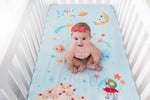 Fitted baby crib sheet by Rookie Humans, Lil' Lamb's Dream. Illustrated by Ellen Giggenbach. Designed for the modern nursery, packaged to make a unique baby shower gift. Light blue crib sheet, stars and planets crib sheet, unicorn pegasus baby nursery. Elephant crib sheet, lambs crib sheet, shooting star crib sheet. Planets, stars, constellations baby nursery room theme.