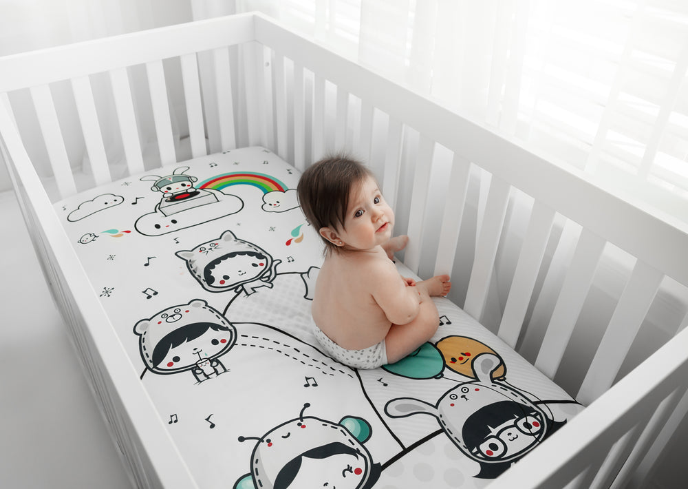Fitted baby crib sheet by Rookie Humans, Party In My Crib. Illustrated by Elisa Sassi. Designed for the modern nursery, packaged to make a unique baby shower gift.