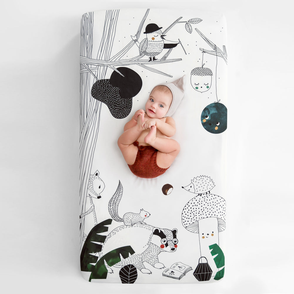 Fitted baby crib sheet by Rookie Humans, Woodland Dreams. Illustrated by Swanjte Hinrichsen. Designed for the modern nursery, packaged to make a unique baby shower gift. Woodland nursery theme.