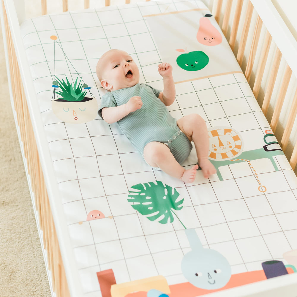 Baby's Room crib sheet by Rookie Humans. Modern crib sheet design has a hanging planter, painting, and toys.