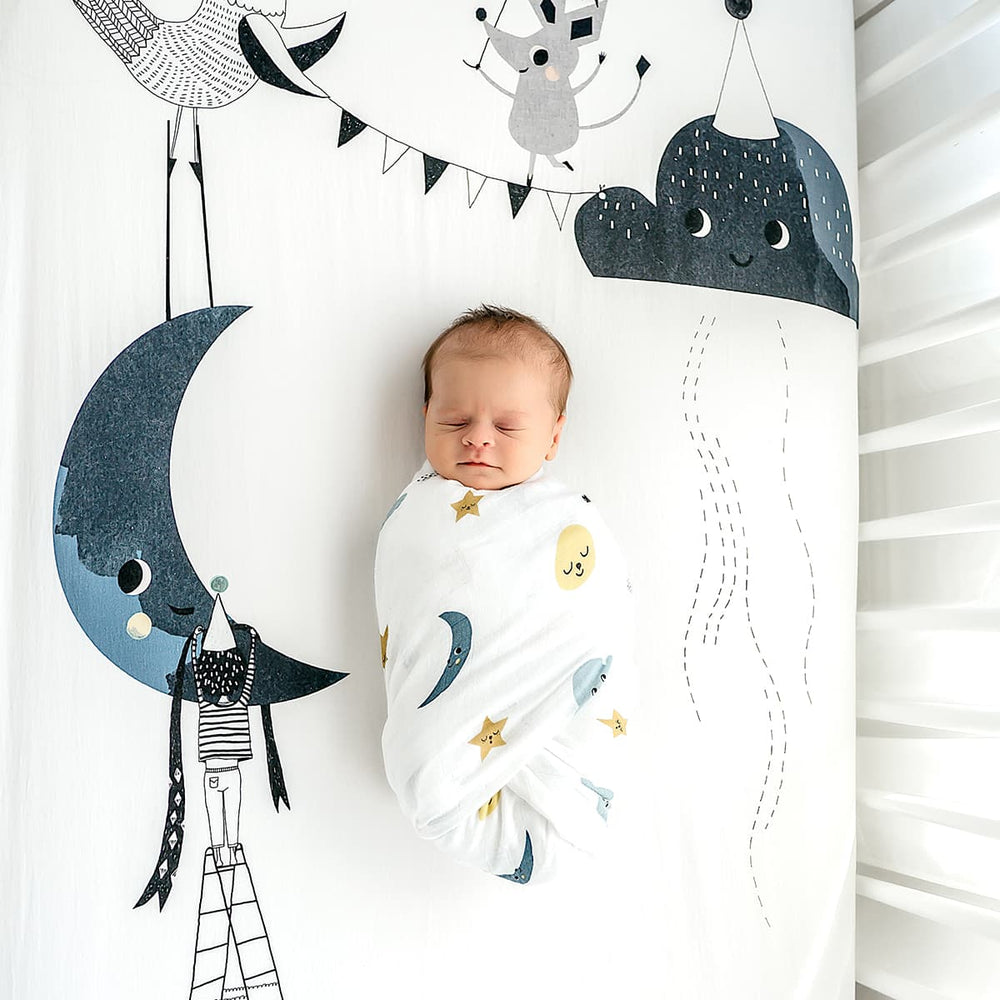 softest baby swaddle, bamboo swaddle moon stars and clouds by Rookie Humans