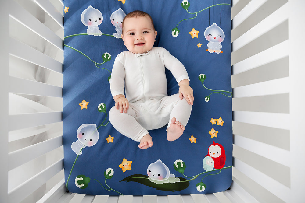 Fitted baby crib sheet by Rookie Humans, Magic Forest. Illustrated by Silvia Portella. Designed for the modern nursery, navy crib sheet.