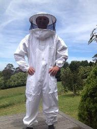 picture of a man wearing beekeeper suit