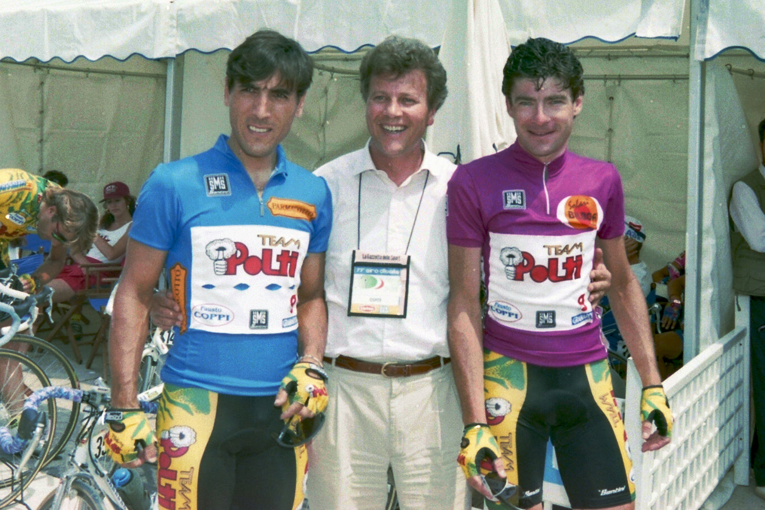 It was all smiles before stage 11 (Marostica - Bibione) of the 1994 Giro D'Italia.  If you have to ride all day, every day in the Polti jersey, it's little wonder why Gianni Bugno and Djamolidine Abduzhaparov look so happy to swap their standard team jersey for the maglia azzurro e maglia ciclamino!  Photo: Fotoreporter Sirotti.
