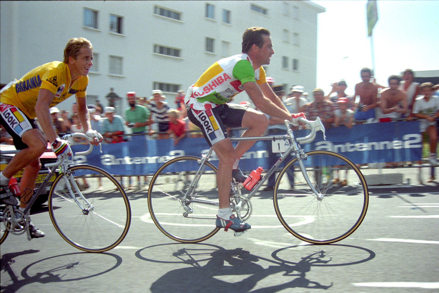 Bernard Hinault (Right, Combination jersey) leads race leader and La Vie Claire team mate Greg Lemond on that famous stage from Briançon to the summit of l'Alpe d'Huez. Photo: Fotoreporter Sirotti.