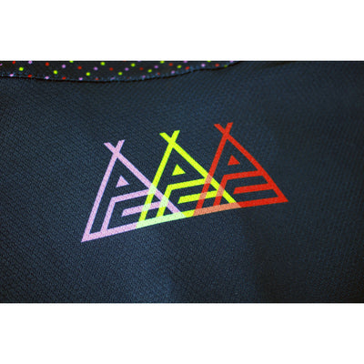 Macro photograph of the jersey sleeve which once again features the 3 different coloured Prendas logos.