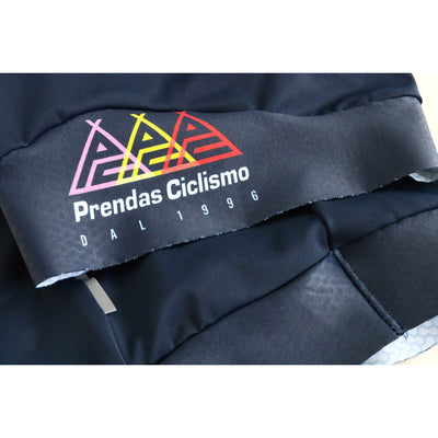 Macro photograph of the Grand Tour bibshorts showing the silicon leg gripper with the Prendas logo in three colours.