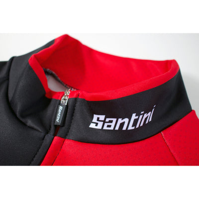 Macro photograph of the Rocket 2.0 long sleeve jersey collar showing the Santini zip puller and the Santini logo.