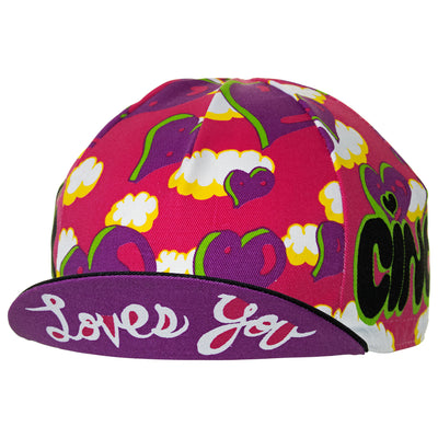 "Peak up view of the Cinelli Ana Benaroya Heart Cotton Cycling Cap, with ""Loves You"" on underside of the peak."