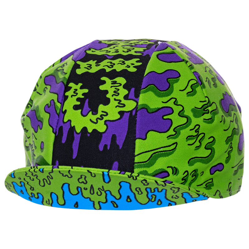 Side view of the Cinelli Ana Benaroya Slime Cotton Cycling Cap, showing the green and purple slime in all it's glory.
