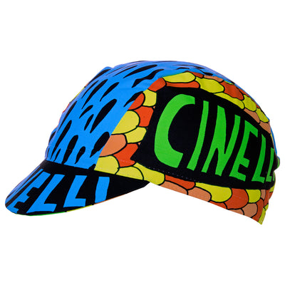 Side view of the Cinelli Ana Benaroya Poseidon Cotton Cycling Cap.  Cinelli is printed on the top of the peak as well as each side.