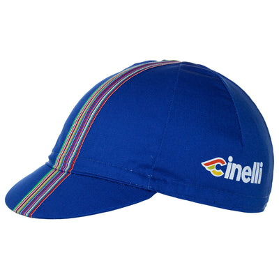 Side of the Cinelli Ciao Blue Cotton Cycling Cap. The Cinelli logo is printed on the side and that wonderful multicoloured woven twill ribbon down the centre.
