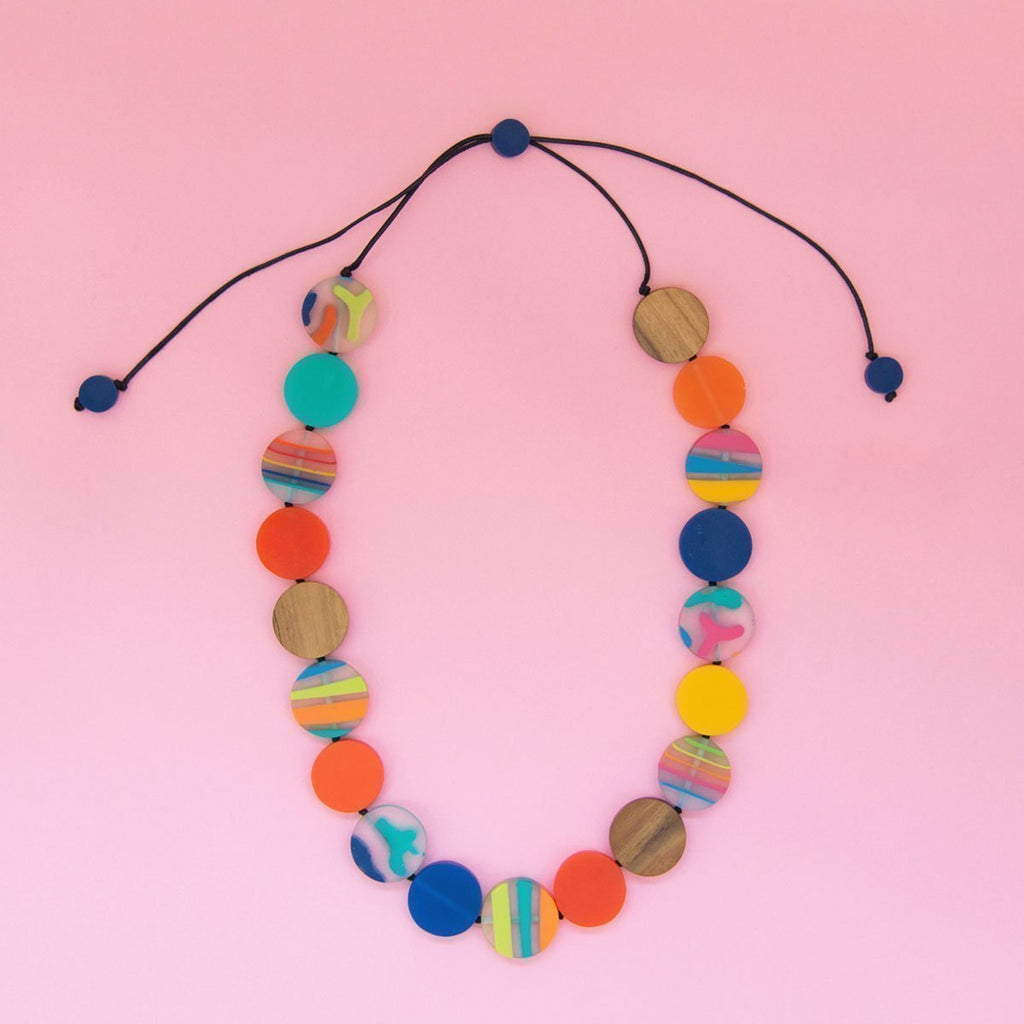 RO1965-M-MULTI-Rainbow-Bright-Long-Disc-Necklace-Pink-Background-1200x1200.jpg