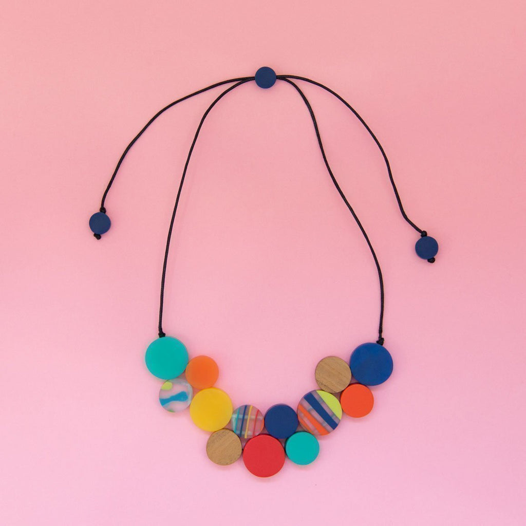 RO1966-M-MULTI-Rainbow-Bright-Short-Disc-Collar-Necklace-Pink-Background-1200x1200.jpg