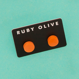 ROW1831ER-Everyday-Flat_stud_Earrings-orange-On-Aqua-1200x1200.png