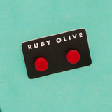 ROW1831ER-Everyday-Flat_stud_Earrings-red-On-Aqua-1200x1200.png