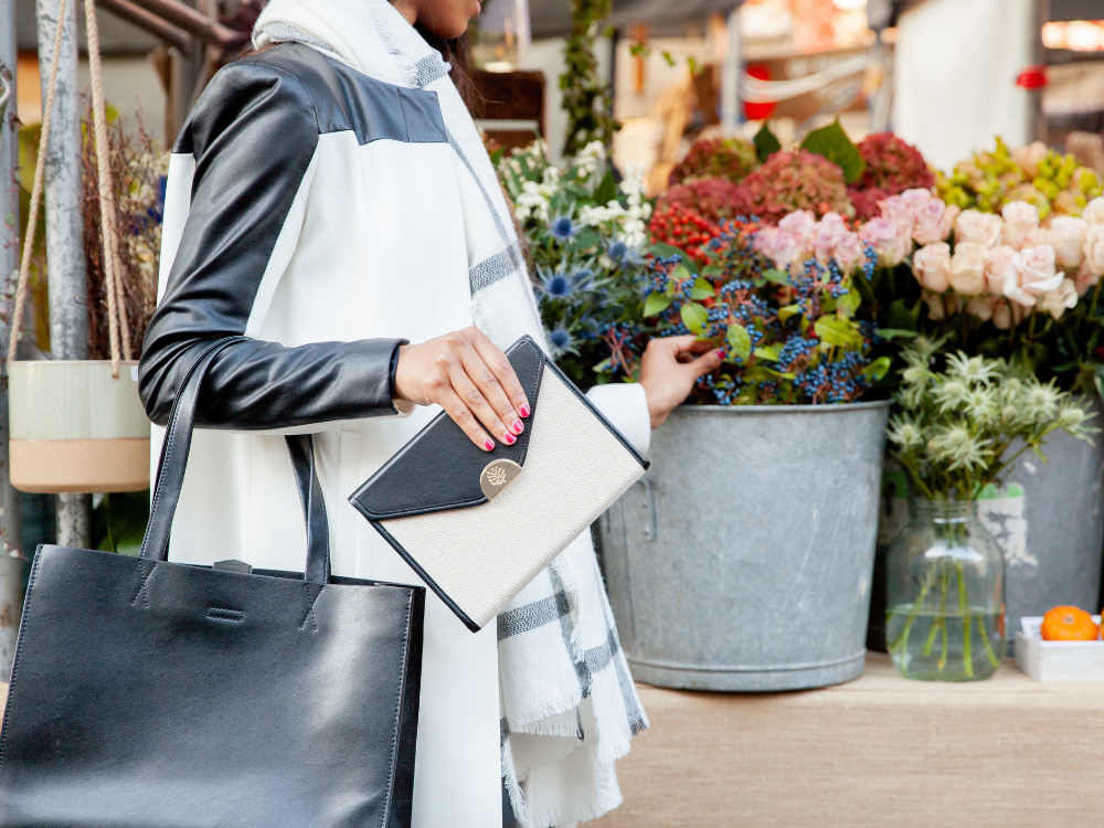 Woman with planner in hand shopping for flowers
