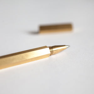 Brass Hexagonal Pen on White Background