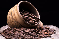 Closeup of coffee beans. Coffee bean on macro ground coffee background. Arabic coffee - ingredient of hot beverage.