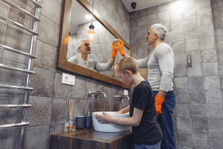 Father & son cleaning bathroom