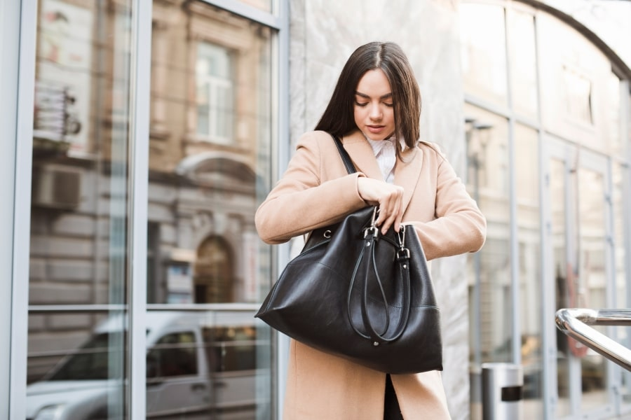 woman searching handbag