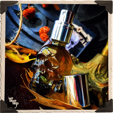 IMMORTAL SKULL POTION. All Natural 1/2oz. Pump Spray. Scent of Patchouli, Clove & Cinnamon. Blessed by Tiger's Eye, Moonstone & Amethyst Crystals.