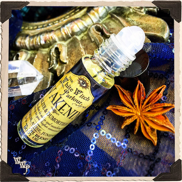 AWAKENING Elixir 1/3oz. BODY OIL Rollon. Scent of Citrus, Anise & Juniper. Blessed by Sodalite & Dumortierite Crystals.